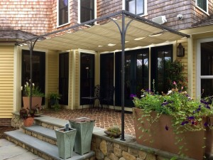 Retractable Bronze and Fabric Awning