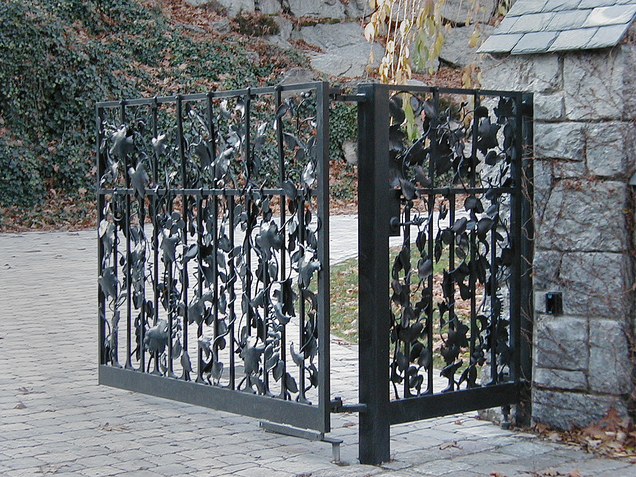 artisan iron leaf covered driveway gate