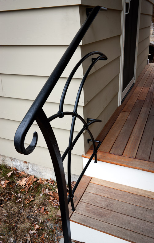 Small forged handrail with pierced detail.