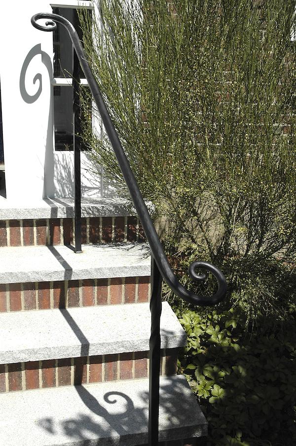 Reverse Scroll Handrail